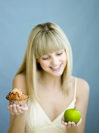 make the right choice - girl holding apple and cake